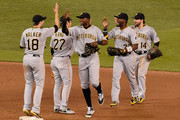 (L-R) Neil Walker #18 , Jung Ho Kang #27, Gregory Polanco #25, Andrew McCutchen #22 and Jaff Decker #14 of the Pittsburgh Pirates celebrate a win of the game against the Minnesota Twins on July 28, 2015 at Target Field in Minneapolis, Minnesota. The Pirates defeated the Twins 8-7.