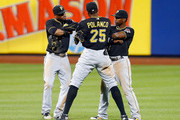 Starling Marte #6 (L), Gregory Polanco #25 and Andrew McCutchen #22 of the Pittsburgh Pirates celebrate after defeating the New York Mets at Citi Field on August 14, 2015 in the Flushing neighborhood of the Queens borough of New York City.