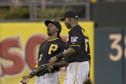 Outfielders Andrew McCutchen #22 and Gregory Polanco #25 of the Pittsburgh Pirates celebrate their win over the Philadelphia Phillies  on September 10, 2014 at Citizens Bank Park in Philadelphia, Pennsylvania. The Pirates defeated the Phillies 6-3