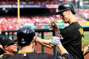 Justin Morneau #66 of the Pittsburgh Pirates is greeted at the dugout after scoring in the fifth inning against the Pittsburgh Pirates during Game Two of the National League Division Series at Busch Stadium on October 4, 2013 in St Louis, Missouri.