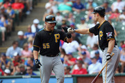 Russell Martin #55 of the Pittsburgh Pirates celebrates a run with Justin Morneau #66 against the Texas Rangers in the fourth inning at Rangers Ballpark in Arlington on September 11, 2013 in Arlington, Texas.