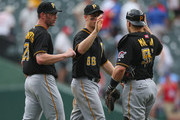 (L-R) Kyle Farnsworth #25, Justin Morneau #66 and Russell Martin #55 of the Pittsburgh Pirates celebrate a win against the Texas Rangers at Rangers Ballpark in Arlington on September 11, 2013 in Arlington, Texas.