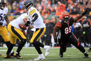 Ben Roethlisberger #7 of the Pittsburgh Steelers attempts to scramble away from Andrew Billings #99 of the Cincinnati Bengals during the first quarter at Paul Brown Stadium on October 14, 2018 in Cincinnati, Ohio.