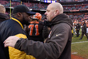 Head coach Mike Pettine of the Cleveland Browns congratulates head coach Mike Tomlin of the Pittsburgh Steelers after Pittsburgh's 28-12 win at FirstEnergy Stadium on January 3, 2016 in Cleveland, Ohio.