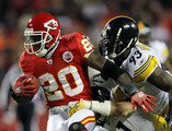 Thomas Jones #20 of the Kansas City Chiefs is tackled as he carries the ball during the game against the Pittsburgh Steelers on November 27, 2011 at Arrowhead Stadium in Kansas City, Missouri.