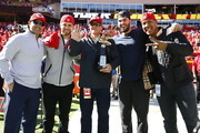 Kansas City Royals Pedro Grifol, Drew Butera, Ned Yost, Eric Hosmer, and Salvador Perez are recognized with the American League Championship Trophy before the game between the Pittsburgh Steelers and the  Kansas City Chiefs at Arrowhead Stadium on October 25, 2015 in Kansas City, Missouri.