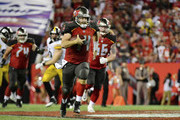 Ryan Fitzpatrick #14 of the Tampa Bay Buccaneers runs for a first down in the fourth quarter Pittsburgh Steelers on September 24, 2018 at Raymond James Stadium in Tampa, Florida.