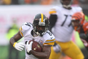 Antonio Brown #84 of the Pittsburgh Steelers carries the ball during the third quarter of the game against the Cincinnati Bengals at Paul Brown Stadium on October 14, 2018 in Cincinnati, Ohio.