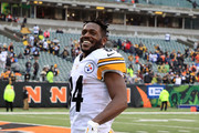 Antonio Brown #84 of the Pittsburgh Steelers celebrates as he walks off of the field after defeating the Cincinnati Bengals 28-21 at Paul Brown Stadium on October 14, 2018 in Cincinnati, Ohio.