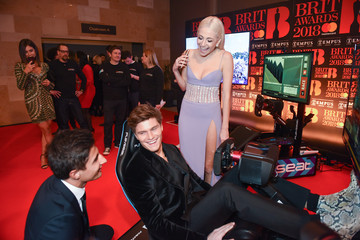 Pixie Lott Oliver Cheshire Formula E Simulators at the BRIT Awards 2018 After-Party