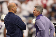 Head coaches (L-R) James Franklin of the Penn State Nittany Lions and Chris Petersen of the Washington Huskies talk before the start of the Playstation Fiesta Bowl at University of Phoenix Stadium on December 30, 2017 in Glendale, Arizona.