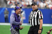 Head coach Chris Petersen of the Washington Huskies argues a call with headlinesman Al Green during a game against the Penn State Nittany Lions during the Playstation Fiesta Bowl at University of Phoenix Stadium on December 30, 2017 in Glendale, Arizona. Penn State won 35-28.