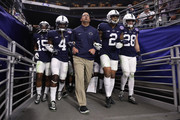 (L-R) Grant Haley #15, Nick Scott #4, head coach James Franklin, Marcus Allen #2 and Troy Apke #28 of the Penn State Nittany Lions walk out to field arm in arm before the start of the second half of the Playstation Fiesta Bowl against the Washington Huskies at University of Phoenix Stadium on December 30, 2017 in Glendale, Arizona. The Nittany Lions defeated the Huskies 35-28.