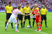 Jakub Blaszczykowski of Poland  shakes hands with Andrey Arshavin of Russia ahead of the UEFA EURO 2012 group A match between Poland and Russia at The National Stadium on June 12, 2012 in Warsaw, Poland.