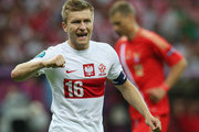 Jakub Blaszczykowski of Poland motivstes the team during the UEFA EURO 2012 group A match between Poland and Russia at The National Stadium on June 12, 2012 in Warsaw, Poland.