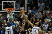 Karl-Anthony Towns #32 of the Minnesota Timberwolves blocks a shot by Damian Lillard #0 of the Portland Trail Blazers as Kevin Garnett #21 of the Minnesota Timberwolves and Mason Plumlee #24 of the Portland Trail Blazers look on during the fourth quarter of the home opening game on November 2, 2015 at Target Center in Minneapolis, Minnesota. The Trail Blazers defeated the Timberwolves 106-101. NOTE TO USER: User expressly acknowledges and agrees that, by downloading and or using this Photograph, user is consenting to the terms and conditions of the Getty Images License Agreement.