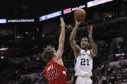 Robin Lopez and Tim Duncan Photos Photo