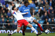 Kanu of  Portsmouth gets tackled by Gael Givet of Blackburn Rovers during the Barclays Premier League match between Portsmouth and Blackburn Rovers at at Fratton Park on April 3, 2010 in Portsmouth, England.