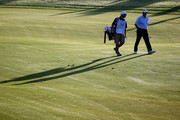 Colin Montgomerie of Scotland walks with his caddie Jason Hempelman on the tenth hole during the first round of the Portugal Masters at the Oceanico Victoria Golf Course on October 15, 2009 in Vilamoura, Portugal.