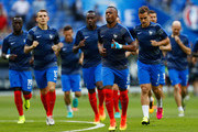 Patrice Evra of France leads his side in the warm up prior to the UEFA EURO 2016 Final match between Portugal and France at Stade de France on July 10, 2016 in Paris, France.