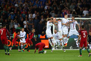 Alfred Finnbogason (4th R) of Iceland blocks a free kick by Cristiano Ronaldo (1st L) of Portugal with his hand resulting in an yellow card during the UEFA EURO 2016 Group F match between Portugal and Iceland at Stade Geoffroy-Guichard on June 14, 2016 in Saint-Etienne, France.