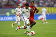 Carlos Vela of Mexico and Nani of Portugal battle for possession during the FIFA Confederations Cup Russia 2017 Group A match between Portugal and Mexico at Kazan Arena on June 18, 2017 in Kazan, Russia.