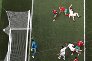 Cristiano Ronaldo of Portugal scores his team's first goal past Monir El Kajoui  during the 2018 FIFA World Cup Russia group B match between Portugal and Morocco at Luzhniki Stadium on June 20, 2018 in Moscow, Russia.