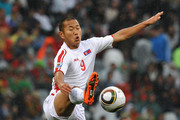 Jong Tae-Se of North Korea jumps to control the ball during the 2010 FIFA World Cup South Africa Group G match between Portugal and North Korea at the Green Point Stadium on June 21, 2010 in Cape Town, South Africa.