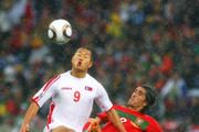 Pedro Mendes of Portugal tackles Jong Tae-Se of North Korea during the 2010 FIFA World Cup South Africa Group G match between Portugal and North Korea at the Green Point Stadium on June 21, 2010 in Cape Town, South Africa.