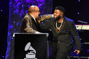 """(L-R) Clive Davis and Khalid speak onstage during the Pre-GRAMMY Gala and GRAMMY Salute to Industry Icons Honoring Sean """"Diddy"""" Combs on January 25, 2020 in Beverly Hills, California."""