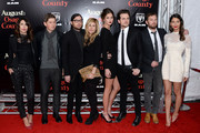 (L-R) Johanna Bennett, Matthew Followill, Nathan Followill, Jessie Baylin, Martha Patterson, Jared Followill, Caleb Followill and Lily Aldridge attend the premiere of 'August: Osage County' presented by The Weinstein Company with Ram Trucks on December 12, 2013 in New York City.