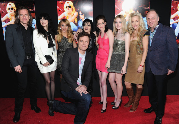 "(L-R) Producer William Phload, director Floria Sigismondi, actress Stella Maeve, actor Michael Shannon, musician Joan Jett, actresses Kristen Stewart, Dakota Fanning, musician Cherie Currie, and CEO of Apparition Bob Berney arrive at the premiere of Apparition's ""The Runaways"" held at ArcLight Cinemas Cinerama Dome on March 11, 2010 in Los Angeles, California."