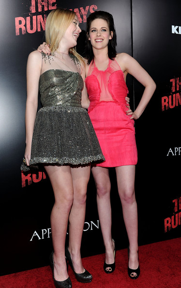 "Actresses Dakota Fanning (L) and Kristen Stewart arrive at the premiere of Apparition's ""The Runaways"" held at ArcLight Cinemas Cinerama Dome on March 11, 2010 in Los Angeles, California."
