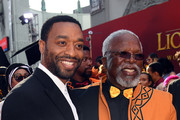 """(L-R) Chiwetel Ejiofor and John Kani attend the premiere of Disney's """"The Lion King"""" at Dolby Theatre on July 09, 2019 in Hollywood, California."""