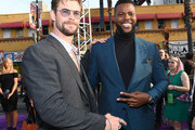 Chris Hemsworth (L) and Winston Duke attend the premiere of Disney and Marvel's 'Avengers: Infinity War' on April 23, 2018 in Los Angeles, California.