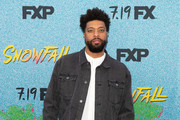 """Deray Davis arrives to the premiere Of FX's """"Snowfall"""" Season 2 at Regal Cinemas L.A. LIVE Stadium 14 on July 16, 2018 in Los Angeles, California."""