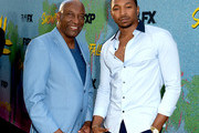 "John Singleton (L) and actor Malcolm Mays arrive at the premiere of FX's ""Snowfall"" Season 2 at the Regal Cinemas L.A. LIVE Stadium 14 on July 16, 2018 in Los Angeles, California."