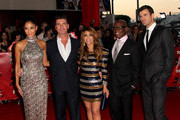 """(L-R) Television show judges, Nicole Scherzinger, Simon Cowell, Paula Abdul, L.A. Reid, and show host Steve Jones arrive at the premiere Of Fox's """"The X Factor"""" held at ArcLight Cinemas Cinerama Dome on September 14, 2011 in Hollywood, California."""