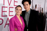 """Haley Lu Richardson (L) and Cole Sprouse arrive at the premiere of CBS Films' """"Five Feet Apart"""" at the Fox Bruin Theatre on March 07, 2019 in Los Angeles, California."""