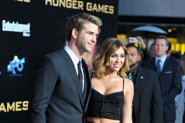 """Miley Cyrus Liam Hemsworth Premiere Of Lionsgate's """"The Hunger Games"""" - Arrivals"""