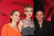 (L-R) Producer Nina Jacobson, actress Jennifer Lawrence and producer Jon Kilik attend premiere of Lionsgate's 'The Hunger Games: Catching Fire' - Red Carpet at Nokia Theatre L.A. Live on November 18, 2013 in Los Angeles, California.