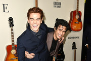 """K.J. Apa, Charles Melton attend the Premiere Of Lionsgate's """"I Still Believe"""" at ArcLight Hollywood on March 07, 2020 in Hollywood, California."""