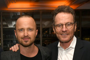 """Aaron Paul (L) and Bryan Cranston pose at the after party for the premiere of Netfflix's """"El Camino: A Breaking Bad Movie"""" at Baltaire on October 07, 2019 in Los Angeles, California."""