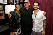 "(L-R) Renee Elise Goldsberry, Vin Diesel and Tyler Posey pose at the after party for the premiere of Netflix's ""Fast And Furious: Spy Racers"" at CityWalk Hollywood on December 07, 2019 in Universal City, California."