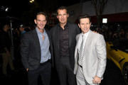 """(L-R) Peter Berg, Netflix VP of Original Film Scott Stuber, and Mark Wahlberg attend the Premiere of Netflix's """"Spenser Confidential"""" at Regency Village Theatre on February 27, 2020 in Westwood, California."""