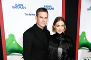 """Michael C. Hall and Morgan Macgregor attend the premiere of New Line Cinema and Warner Bros. Pictures' """"Game Night"""" at TCL Chinese Theatre on February 21, 2018 in Hollywood, California."""