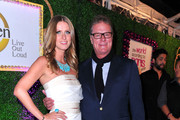 "Nicky Hilton and Chairman and co-founder of Hilton & Hyland Rick Hilton arrive at premiere of Oxygen's New Docu-Series ""The World According To Paris"" at Tropicana Bar at The Hollywood Roosevelt on May 17, 2011 in Los Angeles, California."