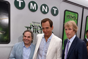 (L-R) Paramount Film Group President Adam Goodman, actor Will Arnett and producer Michael Bay attend the premiere of Paramount Pictures' 'Teenage Mutant Ninja Turtles' at Regency Village Theater on August 3, 2014 in Westwood, California.