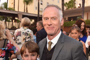 """Director Alan Taylor and his son pose at the after party for the premiere of Paramount Pictures' """"Terminator Genisys"""" at the Roosevelt Hotel on June 28, 2015 in Los Angeles, California."""