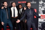 "(L-R) Pablo Schreiber, Christian Gudegast, 50 Cent and Gerard Butler attend the premiere of STX Films' ""Den of Thieves"" at Regal LA Live Stadium 14 on January 17, 2018 in Los Angeles, California."